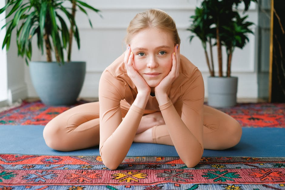 A young girl sitting on a table